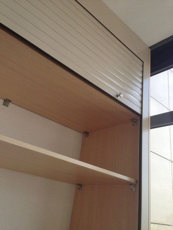Шкаф на балкон с рольставнями на заказ