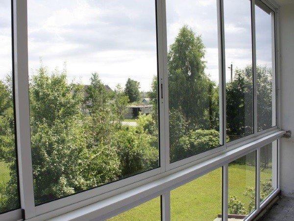 Теплое застекление балкона алюминием