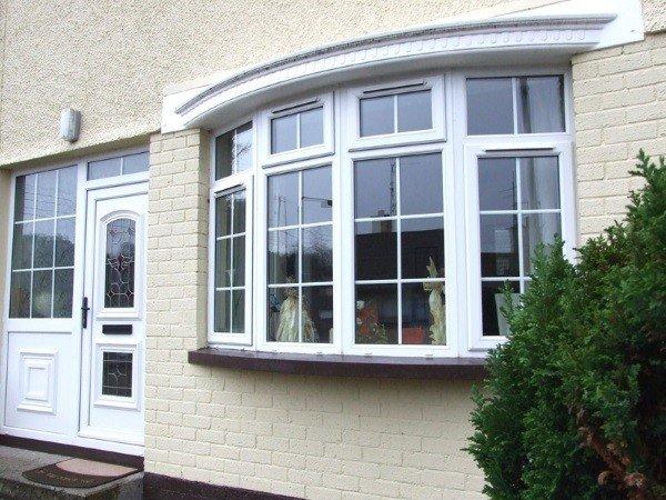 Эркерные окна для коттеджа