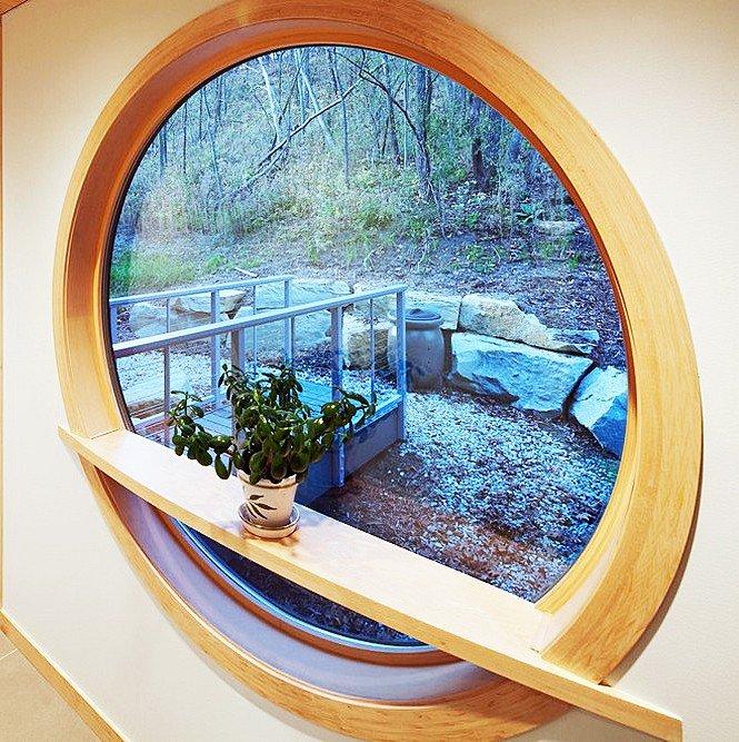 Круглые окна из дерева